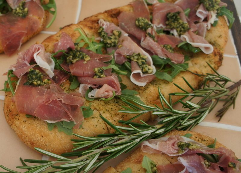 Flatbread topped with Parma ham, wild rocket and pesto