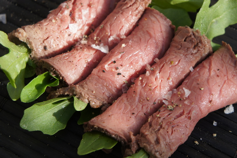 Rare roasted beef rolled in 5 peppercorn with horseradish and wild rocket