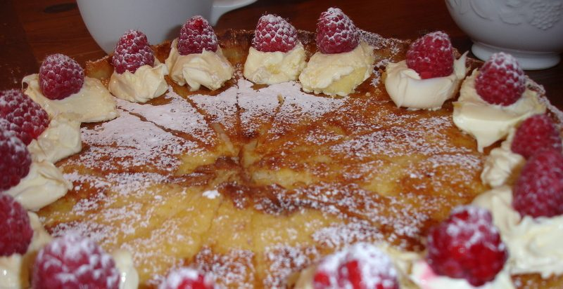 Baked Lemon tart with raspberries