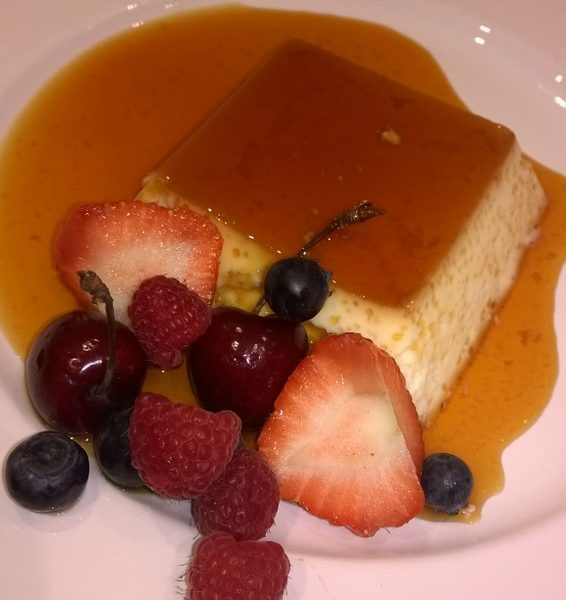 Creme caramel with seasonal fruits