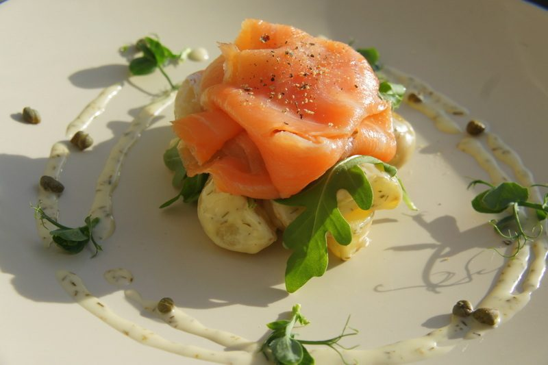 Warm potato salad with smoked salmon and honey, lemon and dill dressing