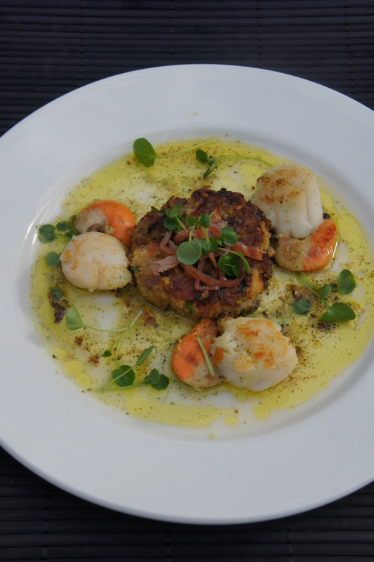 Sauteed scallops with chickpea cake and pancetta