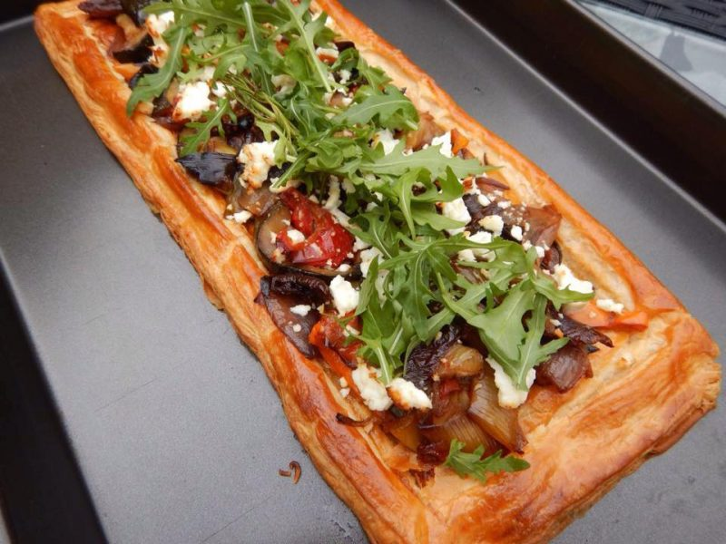 ustic pastry slice with roasted mediterranean vegetable, feta cheese and wild rocket